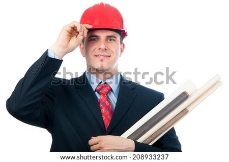 Handsome smiling engineer with hard hat on his head and blueprints in his arms isolated on white. - stock photo