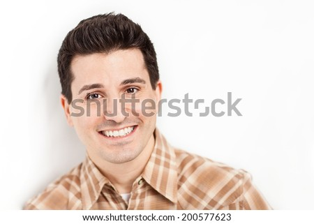 Handsome smiling happy young man closeup  - stock photo