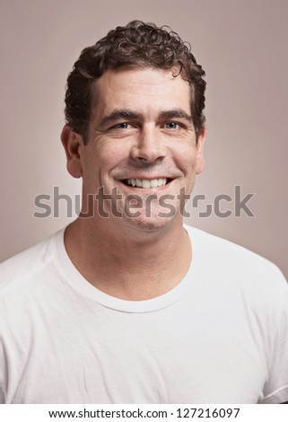 Handsome smiling man in white tee-shirt - stock photo