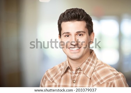 Handsome smiling young man headshot - stock photo