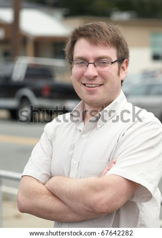 Handsome smiling young man with glasses outdoor portrait - stock photo