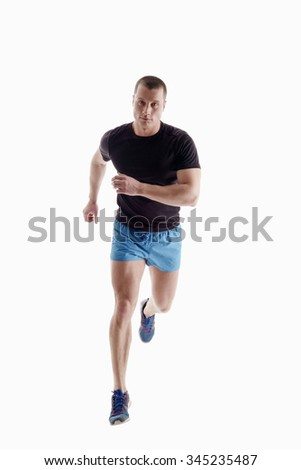 Handsome sportsman runs. Isolated on white - stock photo