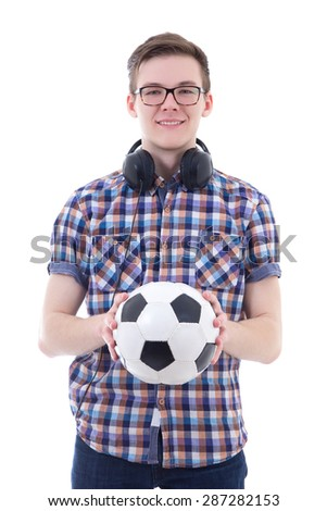 handsome teenage boy with headphones and soccer ball isolated on white background - stock photo