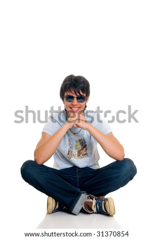 Handsome teenager boy, casual dressed, wearing sunglasses, hip hop culture.  Studio shot, white background - stock photo