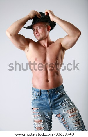 Handsome topless man with a cowboy hat - stock photo