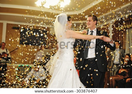 handsome wedding dance with confetti - stock photo