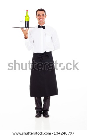 handsome wine steward with tray of wine and glass - stock photo