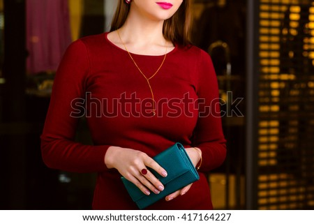 handsome woman holding wallet. Shopping center, shopping, go shopping.  - stock photo