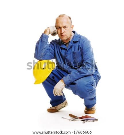 handsome worker looking at camera. isolated on white - stock photo