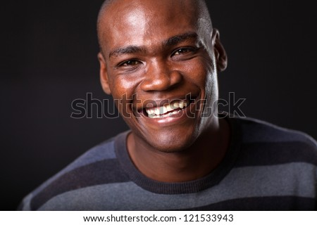 handsome young african american man on black background - stock photo