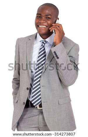 handsome young african businessman talking on smart phone - stock photo