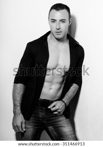 handsome young and fit bodybuilder - stock photo