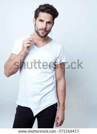 handsome young and fit man ready for workout - stock photo