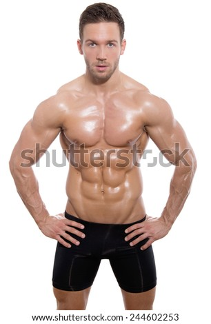 handsome young bodybuilder posing on isolated white background - stock photo