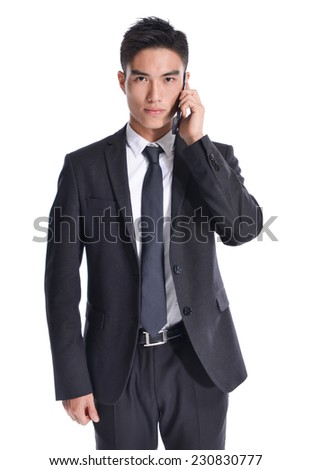 handsome young business asian man using cell phone - stock photo