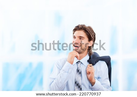 Handsome young business man happy smile over city street buildings background, businessman hold hand on chin think looking side to copy space - stock photo