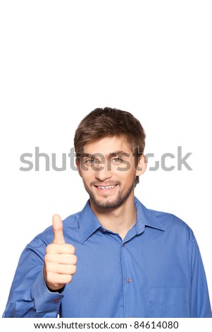 Handsome young business man holding thumb up sign, isolated over white background. series of portrait photos. - stock photo