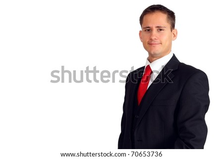 Handsome young business man in a suit and west - stock photo