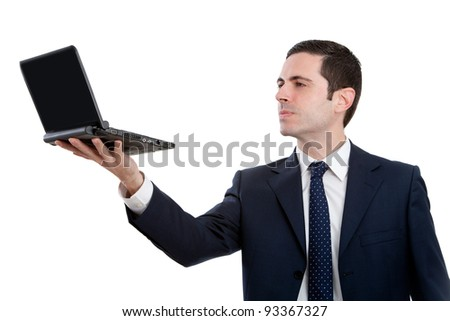 Handsome young business man in blue suit holding  laptop up high. Isolated on white. - stock photo