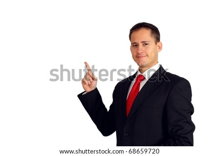 Handsome young business man pointing up to his right side - stock photo