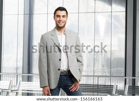 Handsome young business man portrait - stock photo