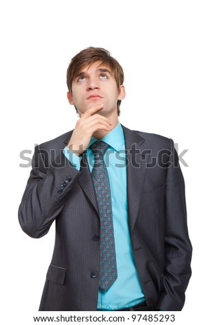 Handsome young business man think looking up to empty copy space, businessman hold hand behind head, wear elegant suit and tie, concept of advertisement product isolated over white background - stock photo