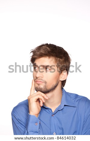 Handsome young business man thinking, isolated over white background. series of portrait photos. - stock photo