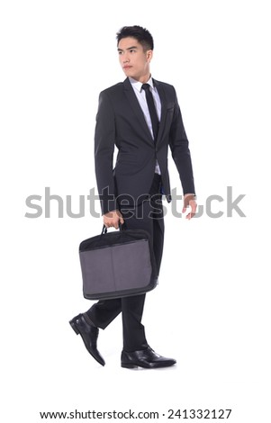 handsome young business man walking carrying a suitcase �full body - stock photo