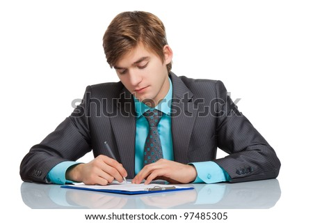 Handsome young business man writing, businessman working with documents sign up contract, sitting at the desk at office, wear elegant suit and tie isolated over white background - stock photo