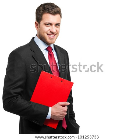 Handsome young businessman holding a clipboard isolated on white - stock photo