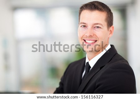 handsome young  businessman in a black suit - stock photo