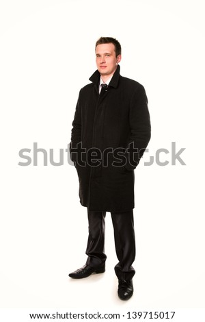 Handsome young businessman in a coat  isolated on white - stock photo
