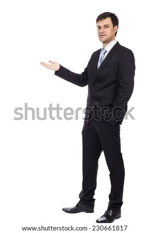 Handsome young businessman making welcome gesture isolated over white background - stock photo