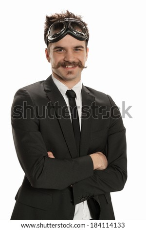Handsome young businessman wearing a pair of avaitor's goggles - stock photo