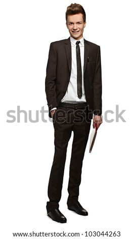 Handsome young businessman with a folder in his hands  with a slight smile on his face - stock photo