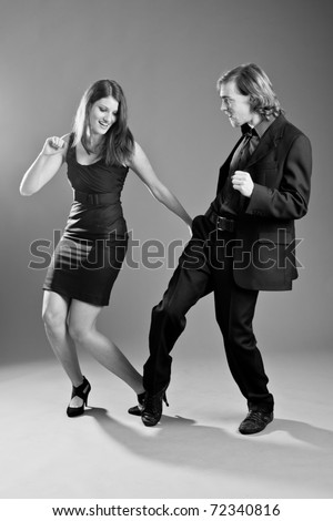 Handsome young couple having a good time dancing together - stock photo