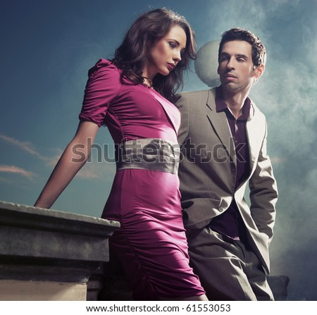 Handsome young couple standing - stock photo