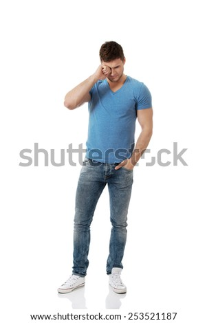 Handsome young depressed man crying. - stock photo