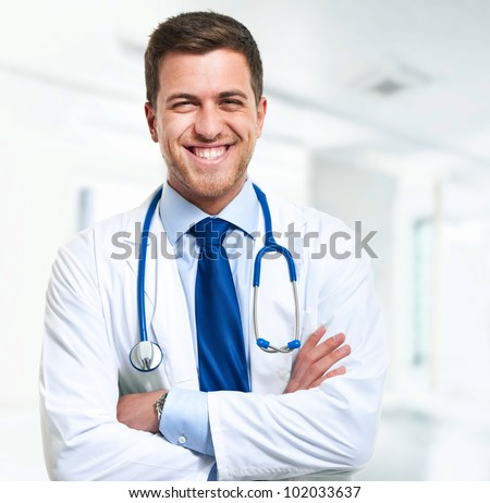 handsome young doctor portrait - stock photo