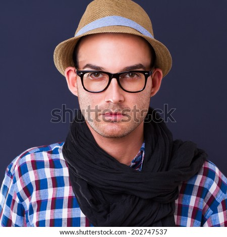 handsome young fashion man wearing scarf and hat - stock photo