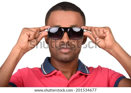 Handsome young fashionable attractive african man wearing sunglasses, isolated on white background - stock photo
