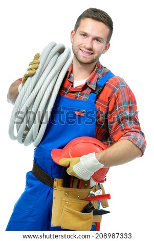 Handsome young handyman isolated on white background - stock photo