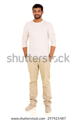 handsome young indian man standing on white background - stock photo