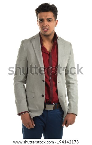 Handsome young Indian man with a sad expression - stock photo
