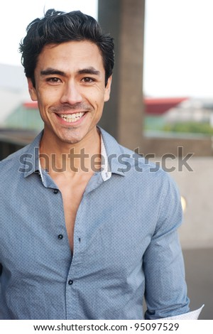 Handsome, young latino professional businessman - stock photo