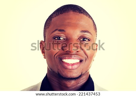 Handsome young male businessman smiling - stock photo