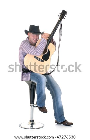 Handsome young male country & western singer, performer with guitar.  Studio shot, white background. - stock photo