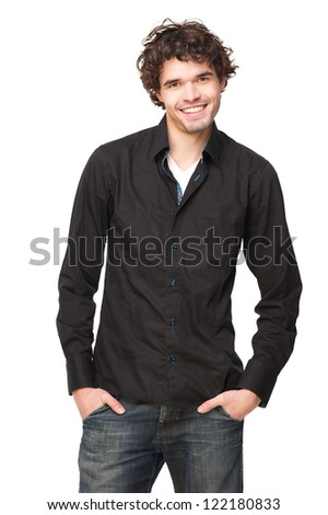 Handsome young male model smiling and looking at the camera happy man is in a casual pose with his hands in his pockets. Isolated on white background - stock photo
