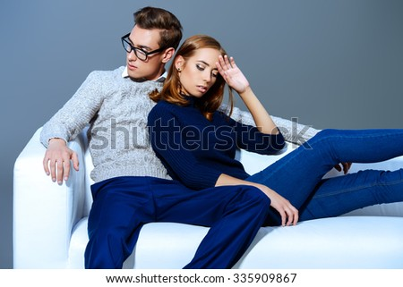Handsome young man and beautiful young woman together. Fashion shot. - stock photo