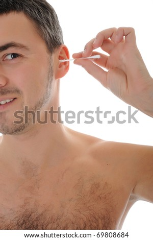 handsome young man cleaning ears with cotton pad stick. isolated on white background - stock photo